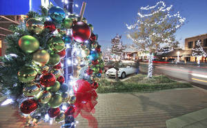 photo - Above and right: Colorful ornaments and bright lights decorate wreaths throughout Edmond for the Christmas season. PHOTOS BY DAVID MCDANIEL, THE OKLAHOMAN