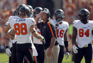 Photo - Oklahoma State special teams coach Joe DeForest talks to players during first half of a college football game between the Oklahoma State University Cowboys (OSU) and the University of Texas Longhorns (UT) at Darrell K Royal-Texas Memorial Stadium in Austin, Texas, Saturday, Oct. 15, 2011. Photo by Sarah Phipps, The Oklahoman  ORG XMIT: KOD