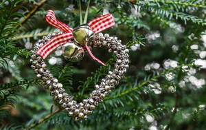 Photo - Heart made of jingle bells on Christmas tree