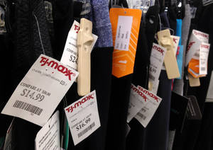 Photo -      Price tags hang on merchandise at T.J. Maxx in North Andover, Mass.  AP File Photo  <strong>Elise Amendola -  AP </strong>