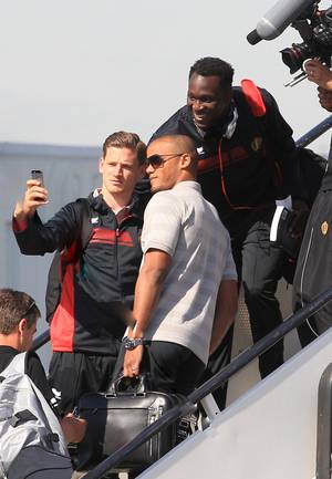 Photo - Belgian soccer players Vincent Kompany, center, Romelu Lukaku, top right, and Jan Vertonghen pose for a selfie prior to embarking the plane, departing from Brussels airport to Sao Paulo Brazil, in Brussels, Tuesday, June 10, 2014. Belgium will play against South Korea, Russia and Algeria in Group H of the World Cup 2014 in Brazil. (AP Photo/Yves Logghe)