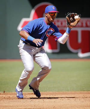 Photo - Chicago Cubs' Starlin Castro fields a ground out hit by Arizona Diamondbacks' Eric Chavez during the second inning of an exhibition spring training baseball game, Saturday, March 29, 2014, in Phoenix. (AP Photo/Matt York)