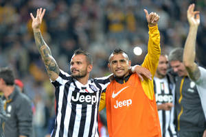 Photo - Juventus players Simone Pepe, left, and Arturo Vidal celebrate at the end of a Serie A soccer match againsts Atalanta, at the Juventus stadium, in Turin, Italy, Monday, May 6, 2014. Juventus clinched its third straight and 30th overall Serie A title. (AP Photo/Massimo Pinca)