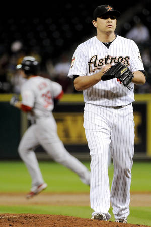 Photo -   Houston Astros relief pitcher Fernando Rodriguez, right, looks off as St. Louis Cardinals' Pete Kozma, left, rounds the bases on a two-run home run in the second inning of a baseball game, Monday, Sept. 24, 2012, in Houston. (AP Photo/Pat Sullivan)