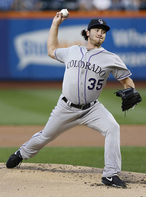 Photo - Colorado Rockies starting pitcher Chad Bettis throws in the first inning of a baseball game against the New York Mets at Citi Field, Tuesday, Aug. 6, 2013, in New York. (AP Photo/John Minchillo)