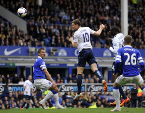 Photo - Manchester City's Edin Dzeko scores the second goal of the game during their English Premier League soccer match against Everton at Goodison Park in Liverpool, England, Saturday May 3, 2014. (AP Photo/Clint Hughes)