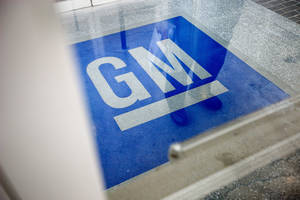 Photo -  The logo for General Motors decorates the entrance at the site of a GM information technology center in Roswell, Ga.  AP Photo  <strong>David Goldman -   </strong>