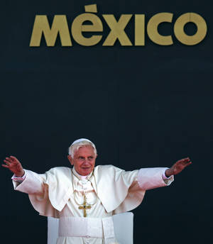 Photo - In this March 26, 2012 photo, Pope Benedict XVI waves to the crowd during his departure ceremony at the airport in Silao, Mexico. On Monday, Feb. 11, the Vatican announced that Pope Benedict XVI will resign on Feb. 28. <strong>Alexandre Meneghini - AP</strong>