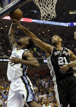 Photo - Memphis Grizzlies guard Tony Allen (9) drives to the basket as San Antonio Spurs forward Tim Duncan (21) reaches for the ball during the first half of Game 3 in their NBA basketball Western Conference finals playoff series, Saturday, May 25, 2013, in Memphis, Tenn. (AP Photo/Danny Johnson)