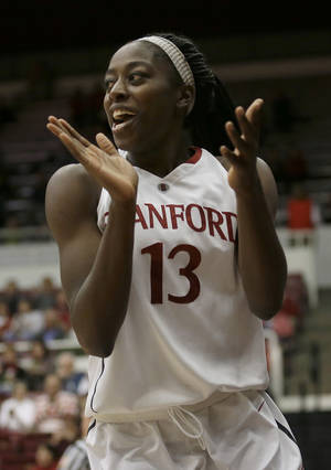 Photo - Stanford forward Chiney Ogwumike (13) celebrates after scoring and being fouled against New Mexico during the first half of an NCAA women's college basketball game in Stanford, Calif., Monday, Dec. 16, 2013. (AP Photo/Jeff Chiu)