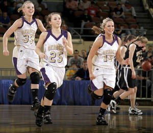 Photo - Okarche's Kristen Meyer, left, Brooke Edwards, and Macy Kunneman celebrate as Seiling's Aubrey Colvard walks of the court during the Class A girls basketball state tournament at the State Fair Arena in Oklahoma City, Friday, March 5, 2010. Photo by Bryan Terry, The Oklahoman