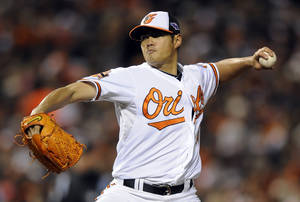 Photo -   Baltimore Orioles starting pitcher Wei-Yin Chen, of Taiwan, throws to the New York Yankees in the second inning of Game 2 of the American League division baseball series on Monday, Oct. 8, 2012, in Baltimore. (AP Photo/Nick Wass)