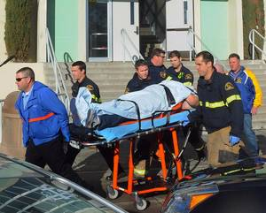 Photo - This image provided by the Taft Midway Driller/Doug Keeler shows paramedics transporting a student wounded during a shooting Thursday Jan. 10, 2013 at San Joaquin Valley high school in Taft, Calif. Authorities said a student was shot and wounded and another student was taken into custody. (AP Photo/Taft  Midway Driller, Doug Keeler)  MANDATORY CREDIT