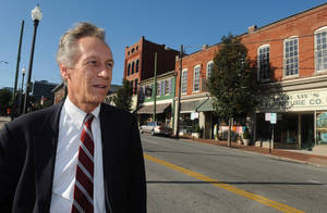Photo -   FILE - In this Sept. 13, 2012 file photo, presidential candidate Virgil Goode Jr. works the campaign trail in downtown Lynchburg, Va. Goode's presidential run is under the Constitution Party banner with his name on the ballot in a couple dozen states and as a qualified write-in candidate in several more. (AP Photo/Don Petersen, File)