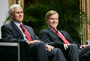 photo -   Indiana Governor-Elect Mike Pence, left, and Republican Governors Association Chairman and Virginia Gov. Bob McDonnell wait for the start of a panel discussion during the 2012 RGA Annual Conference at Encore hotel-casino Thursday, Nov. 15, 2012, in Las Vegas. (AP Photo/Ronda Churchill)  