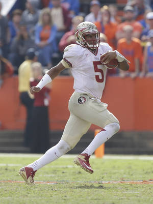 Photo - Florida State quarterback Jameis Winston scrambles for yardage against Florida during the second half of an NCAA college football game in Gainesville, Fla., Saturday, Nov. 30, 2013. Florida State defeated Florida 37-7.(AP Photo/John Raoux)