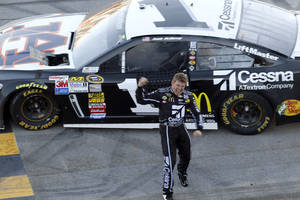 Photo - Sprint Cup Series driver Jamie McMurray (1) celebrates after winning the NASCAR Sprint Cup Series auto race at the Talladega Superspeedway in Talladega, Ala., Sunday, Oct. 20, 2013. (AP Photo/Butch Dill)