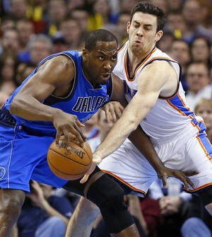 Photo - Oklahoma City's Nick Collison (4) defends Dallas' Elton Brand (42) during an NBA basketball game between the Oklahoma City Thunder and the Dallas Mavericks at Chesapeake Energy Arena in Oklahoma City, Monday, Feb. 4, 2013. Photo by Nate Billings, The Oklahoman