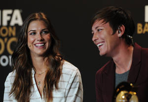 photo - Alex Morgan, left, and Abby Wambach, right, of the United States. nominees for the FIFA Women's World Soccer Player of the Year Award, joke at a press conference during the FIFA Ballon d'Or Gala 2013 held at the Kongresshaus in Zurich, Switzerland, on Monday, Jan. 7, 2013. (AP photo/Keystone/Steffen Schmidt)
