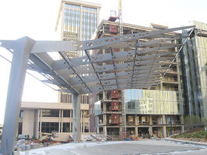 photo - A large steel pavilion now connects the 29-story SandRidge Tower with the Braniff Building, which is getting a new modern glass facade on the former alley side of the 11-story building.Photo by Steve Lackmeyer, The Oklahoman