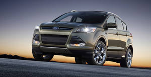 photo -   FILE - This undated file product image provided by the Ford Motor Co. shows the 2013 Ford Escape. Ford is recalling about 7,600 Escape SUVs to fix coolant leaks that can cause fires. The recall affects 2013 Escapes with 1.6-liter four-cylinder engine. (AP Photo/Ford Motor Co., File)