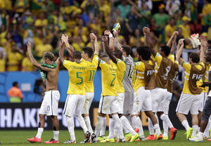Photo - Brazil's Neymar, left, celebrates with his teammates after  a 4-1 win over Cameroon during the group A World Cup soccer match between Cameroon and Brazil at the Estadio Nacional in Brasilia, Brazil, Monday, June 23, 2014. (AP Photo/Dolores Ochoa)