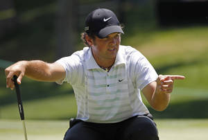 Photo -   Patrick Reed lines up a putt on the 15th green during the first round of the Wells Fargo Championship golf tournament at Quail Hollow Club in Charlotte, N.C., Thursday, May 3, 2012. (AP Photo/Bob Leverone)