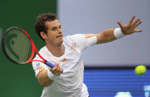Photo -   Andy Murray of Britain returns a shot against Radek Stepanek of the Czech Republic in their men's singles quarterfinal match at the Shanghai Masters tennis tournament at Qizhong Forest Sports City Tennis Center in Shanghai, China, Friday Oct. 12, 2012. (AP Photo/Eugene Hoshiko)