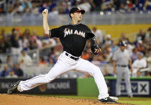Photo - Miami Marlins pitcher Jacob Turner throws against the Milwaukee Brewers in the fourth inning of a baseball game in Miami, Saturday, May 24, 2014. (AP Photo/Joe Skipper)