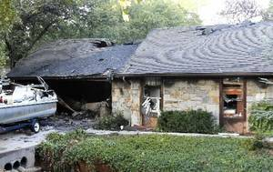 Photo - This home at 1716 Ridgecrest in Edmond, OK, Monday, was gutted by a late night fire. October 1, 2012. By Paul Hellstern