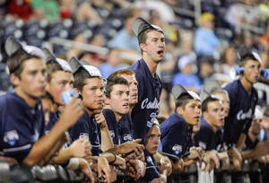 Photo - North Carolina players, including Chris Munnelly, center top, wear their rally caps in the ninth inning of an NCAA College World Series baseball game against UCLA, in Omaha, Neb., Friday, June 21, 2013. UCLA won 4-1. (AP Photo/Francis Gardler)
