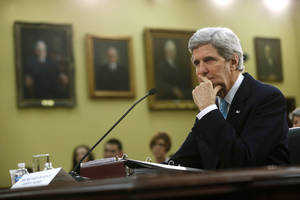 Photo - Secretary of State John Kerry pauses while testifying on Capitol Hill in Washington, Wednesday, March 12, 2014, before the House Appropriations subcommittee on State, Foreign Operations, and Related Programs Budget hearing.  Kerry sais he will travel to London to meet Russian Foreign Minister Sergey Lavrov on Friday in a last-ditch bid to avert a new crisis over Ukraine.  (AP Photo/Charles Dharapak)