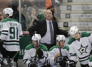 Photo - Dallas Stars' Lindy Ruff, center, looks at the scoreboard during the third period in Game 1 of the first-round NHL hockey Stanley Cup playoff series against the Anaheim Ducks on Wednesday, April 16, 2014, in Anaheim, Calif. The Ducks won 4-3. (AP Photo/Jae C. Hong)