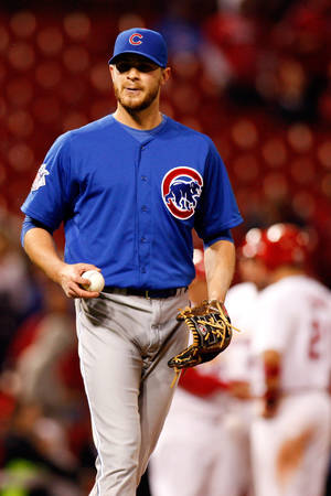 Photo - Chicago Cubs relief pitcher Justin Grimm pauses on the mound during the twelfth inning of a baseball game against the St. Louis Cardinals, Tuesday, May 13, 2014, in St. Louis. (AP Photo/Scott Kane)