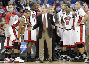 Photo - UNLV head coach Lon Kruger and his players look to the referee in confusion as to who called a timeout in their game against Illinois in the second round of the NCAA Basketball Tournament in Tulsa, OK Mar. 18, 2011. MICHAEL WYKE, Tulsa World