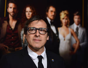 "Photo - FILE - This Dec. 3, 2013 file photo shows director David O. Russell at a special screening of ""American Hustle""in Los Angeles. Russell was nominated for an Academy Award for best director on Thursday, Jan. 16, 2014, for the film. The 86th Academy Awards will be held on March 2. (Photo by Jordan Strauss/Invision/AP, File)"
