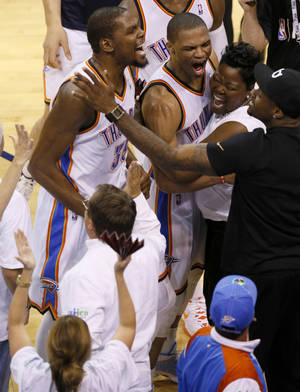 Photo - Oklahoma City's Russell Westbrook (0) and Kevin Durant (35) celebrate with Durant's mother  Wanda Pratt during Game 5 of the Western Conference semifinals in the NBA playoffs between the Oklahoma City Thunder and the Los Angeles Clippers at Chesapeake Energy Arena in Oklahoma City, Tuesday, May 13, 2014. Photo by Bryan Terry, The Oklahoman