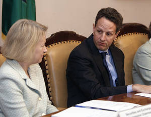photo -   FILE-In this Thursday, June 25, 2009, file photo Treasury Secretary Timothy Geithner, right, and Securities and Exchange Commission (SEC) Mary Schapiro, left,take part in a meeting of the President's Working Group on Financial Markets, at the Treasury Department in Washington. Geithner is putting pressure on the Securities and Exchange Commission to overhaul its rules for money-market mutual funds. Geithner sent a letter Thursday, Sept. 27, 2012, to members of the Financial Stability Oversight Council seeking their help in pressuring the SEC to change its rules. (AP Photo/Ron Edmonds, File)