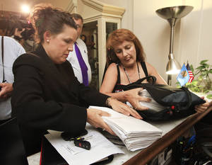 photo - Cindy Jones and Karen Monahan unpack petitions in support of Jerome Earsland on the receptionists desk in the Governor's office at the Capitol in Oklahoma City Thursday, July 7, 2011. Photo by Paul B. Southerland, The Oklahoman