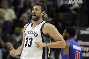 Photo - Memphis Grizzlies' Marc Gasol (33), of Spain, celebrates after a basket during the first half of an NBA basketball game against the Detroit Pistons in Memphis, Tenn., Friday, Nov. 1, 2013. (AP Photo/Danny Johnston)