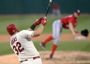 Photo - St. Louis Cardinals' Matt Adams hits a solo home run off Washington Nationals pitcher Stephen Strasburg in the seventh inning of a baseball game Saturday, June 14, 2014, in St. Louis. The Cardinals won 4-1. (AP Photo/St. Louis Post-Dispatch, Chris Lee)