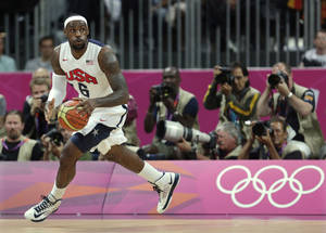 Photo -   United States' Lebron James looks up the court during the first half of a preliminary men's basketball game against France at the 2012 Summer Olympics, Sunday, July 29, 2012, in London. (AP Photo/Charles Krupa)