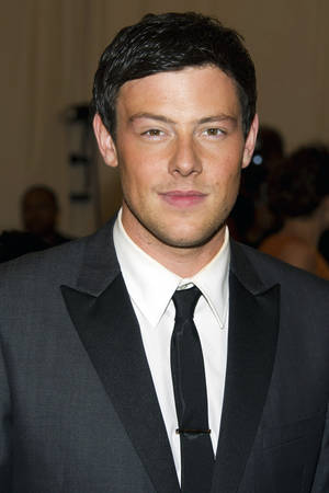 Photo - FILE - In this May 7, 2012 file photo, Cory Monteith arrives at the Metropolitan Museum of Art Costume Institute gala benefit, celebrating Elsa Schiaparelli and Miuccia Prada in New York. A coroner's final report on Monteith issued Wednesday, Oct. 2, 2013, confirmed initial findings that the 31-year-old Canadian-born actor died from using intravenous heroin combined with alcohol. (AP Photo/Charles Sykes, File)