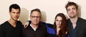 "Photo - From left, actor Taylor Lautner, director Bill Condon, actress Kristen Stewart and actor Robert Pattinson, from ""The Twilight Saga: Breaking Dawn Part 2,"" pose for a portrait in Los Angeles. <strong>Matt Sayles - Matt Sayles/Invision/AP</strong>"