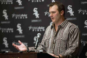 Photo - Chicago White Sox's Paul Konerko speaks during the SoxFest annual fan convention on Friday, Jan. 24, 2014, in Chicago. (AP Photo/Andrew A. Nelles)