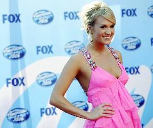 "Photo - Singer Carrie Underwood arrives at the ""American Idol"" finale in Los Angeles, Wednesday, May 20, 2009. AP Photo"