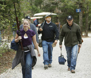 Photo - Sara Graybill, Garrett Graybill, Mike Hames and Curt Avant head to their next shooting station as the Edmond Area Chamber of Commerce hosts its annual sporting clays tournament at Silverleaf Shotgun Sports in Guthrie. PHOTO BY PAUL HELLSTERN, THE OKLAHOMAN