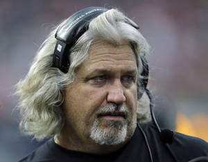 Photo - FILE - In this Aug. 25, 2013, file photo, New Orleans Saints defensive coordinator Rob Ryan looks from the sideline during the second half of a preseason NFL football game against the Houston Texans in Houston. Ryan says his verbal commitment to take a job with the St. Louis Rams was made hastily while he was still upset over his firing in Dallas. (AP Photo/Eric Gay, File)