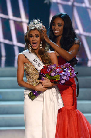 Photo - FILE - In this Sunday, June 16, 2013 file photo, Miss Connecticut Erin Brady is crowned the winner of the Miss USA 2013 pageant by Nana Meriwether in Las Vegas. Brady, of South Glastonbury, Connecticut, relinquishes her crown Sunday June 8, 2014 when the 2014 pageant competition being held in Baton Rouge selects a new Miss USA. (AP Photo/Jeff Bottari, File)