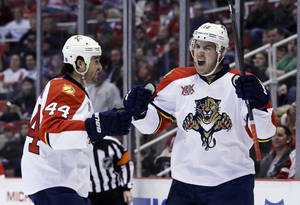 Photo - Florida Panthers right wing Jimmy Hayes, right, reacts next to teammate defenseman Erik Gudbranson (44) after Hayes scored a goal during the second period of an NHL hockey game against the Detroit Red Wings in Detroit, Saturday, Dec. 7, 2013. (AP Photo/Carlos Osorio)